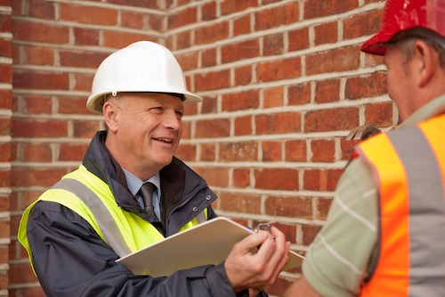 IMAGE OF TWO MEN TALKING - BUILDING A TAILORED POLICY WITH FMB INSURANCE